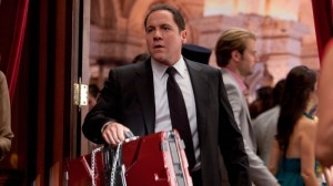 Q 35. Who Does Happy Hogan Work For?